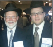Rabbi Dovid Shawel with his son, Akiva